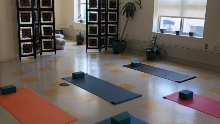 Image of yoga room with yoga mats on floor.