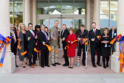 Ribbon cutting ceremony with Chez Veterans Center stakeholders in front of Center building.